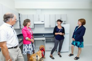 Community Leaders View a Unit at Orca Place